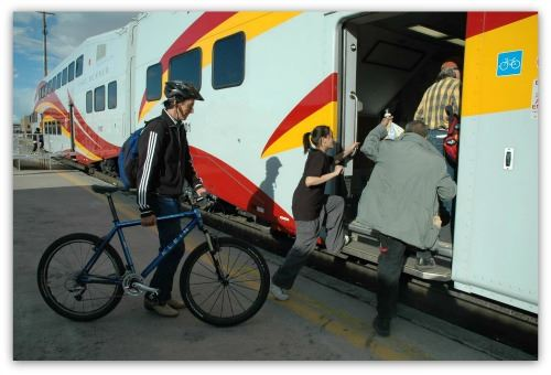 A Passenger Boarding Bike on the Train